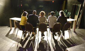 Cast back-light onstage at The Weekend Theater